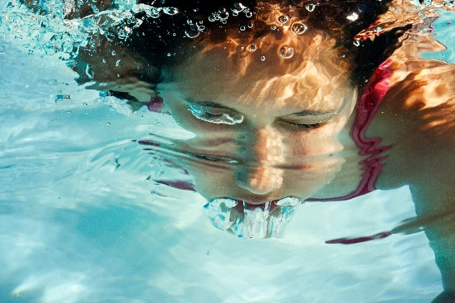 icy woman swimming